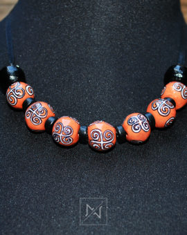 Necklace decorated with swirling pattern